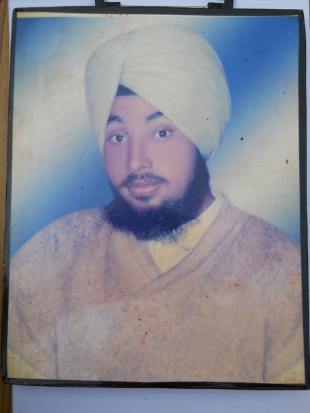 Photo of Pargat Singh, victim of extrajudicial execution between July 1, 1992 and August 31,  1992, in Batala, by Punjab Police; Black cat
