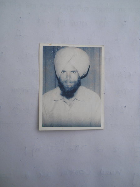 Photo of Lakhwinder Singh, victim of extrajudicial execution on May 08, 1993, in Manochahal,  by Punjab Police; Black cat, in Manochahal, by Punjab Police