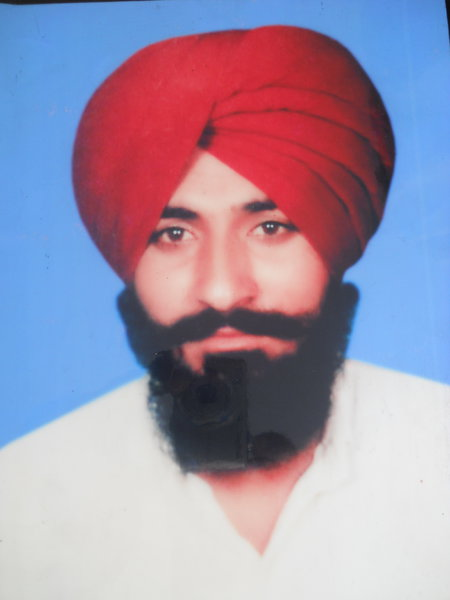 Photo of Jagtar Singh, victim of extrajudicial execution on October 27, 1989, in Amritsar,  by Punjab Police; Black cat, in Amritsar, by Punjab Police