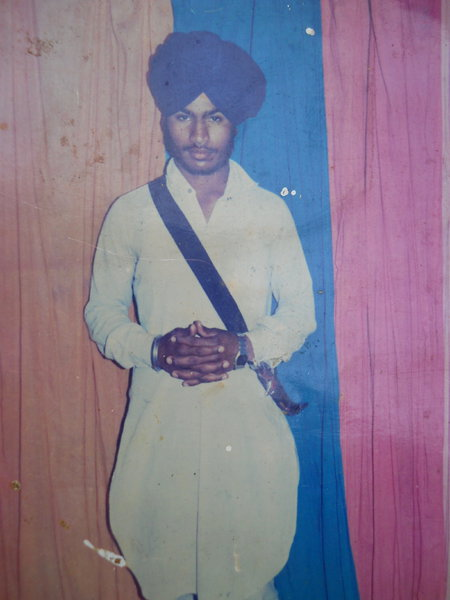 Photo of Harjit Singh, victim of extrajudicial execution between January 28, 1993 and February 4,  1993, in Zira, Jhabal Kalan,  by Punjab Police; Black cat, in Jhabal Kalan, by Punjab Police