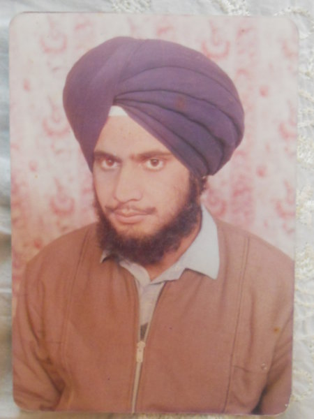 Photo of Jaswinder Singh, victim of extrajudicial execution between January 17, 1993 and February 18,  1993, in Faridkot,  by Punjab Police; Black cat, in Sangrur, by Punjab Police