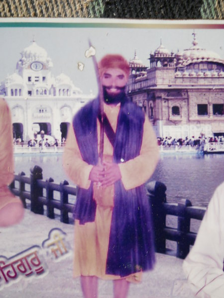 Photo of Gurmail Singh, victim of extrajudicial execution between July 28, 1993 and August 1,  1993, in Raman,  by Punjab Police; Black cat, in Raman, by Punjab Police