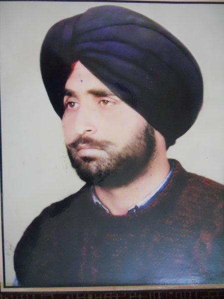 Photo of Tajinder Singh, victim of extrajudicial execution between September 7, 1992 and September 12,  1992, in Jhabal Kalan, Tarn Taran, Tarn Taran CRPF Camp,  by Punjab Police; Central Reserve Police Force; Black cat, in Tarn Taran, by Punjab Police