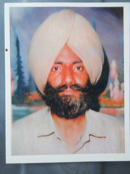 Photo of Niranjan Singh, victim of extrajudicial execution on June 18, 1989, in Ghall Khurd, by Punjab Police; Black cat