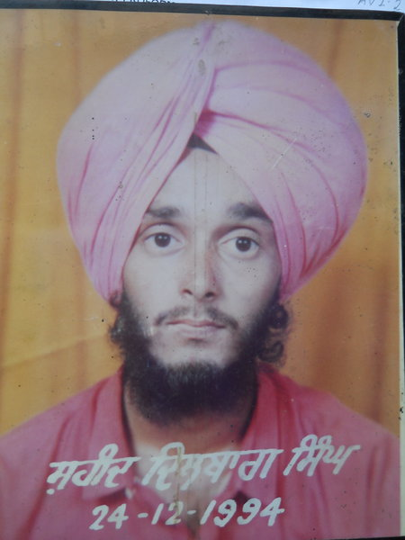 Photo of Dilbagh Singh, victim of extrajudicial execution on December 24, 1994Black cat