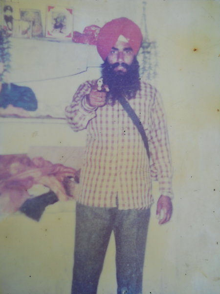 Photo of Mohinder Singh, victim of extrajudicial execution between October 1, 1991 and October 31,  1991, in Mitha, Kahnuwan, Gurdaspur,  by Punjab Police; Black cat, in Mitha, by Black cat