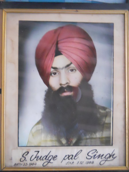 Photo of Judgepal Singh, victim of extrajudicial execution on December 1, 1988Black cat