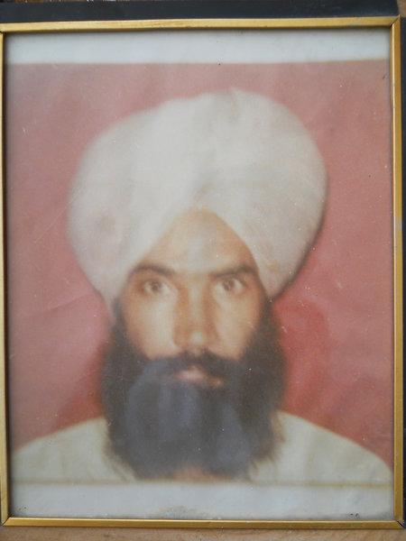 Photo of Satpal Singh, victim of extrajudicial execution between December 1, 1991 and December 31,  1991, in Dasua,  by Punjab Police; Black cat, in Dasua, by Punjab Police