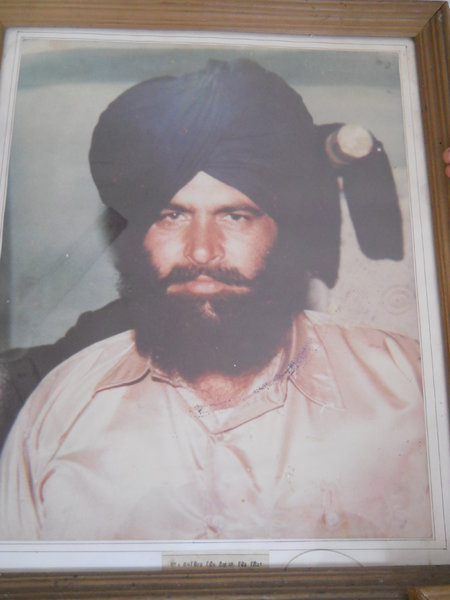 Photo of Lakhbir Singh, victim of extrajudicial execution on March 11, 1988Black cat